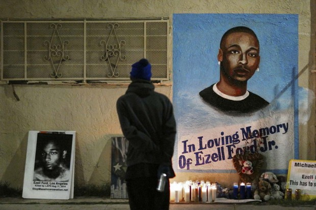 Man stands near mural for Ezell Ford after Los Angeles County Coroner released an autopsy report on the LAPD's shooting of Ford in Los Angeles, California