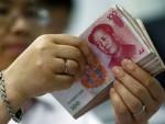 ПЕКИНГ: Потез Кине срозао долар, јуан слави